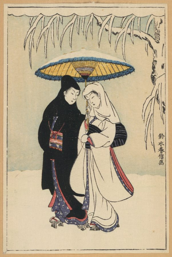 Couple_under_umbrella_in_snow